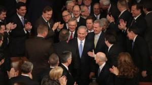 Netanyahu greeted in Congress, photo by Chip Somodevilla / Getty Images. http://www.latimes.com/nation/politics/politicsnow/la-pn-netanyahu-congress-reaction-20150303-story.html